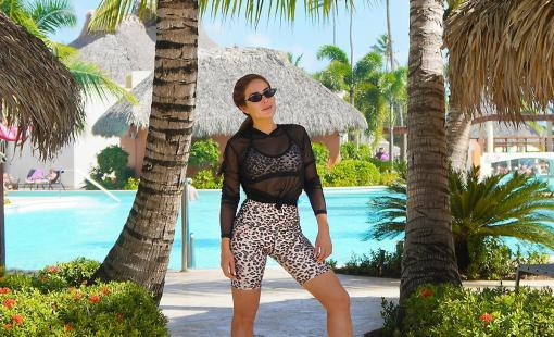 Bianca Jade standing near Breathless Resorts Pool in Punta Cana DR