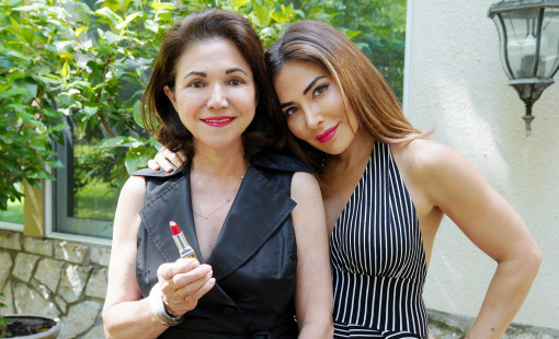 Mother and daughter wearing red lipstick.